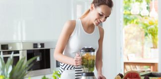 Smiling Woman Making Smoothie