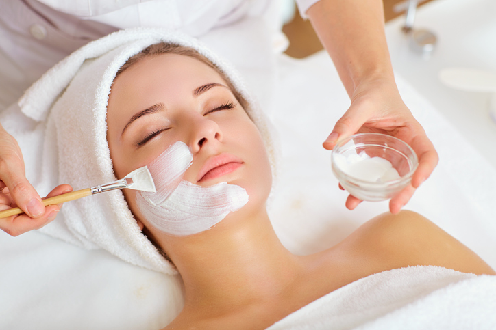 Woman In Mask On Face In Spa Beauty Salon